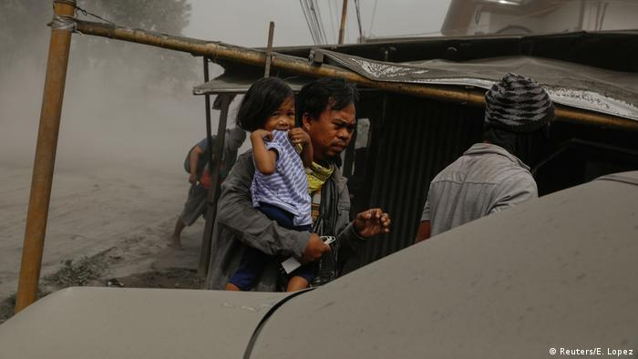 A family evacuates in Lemery, Batangas City on Monday. (Reuters/E. Lopez)