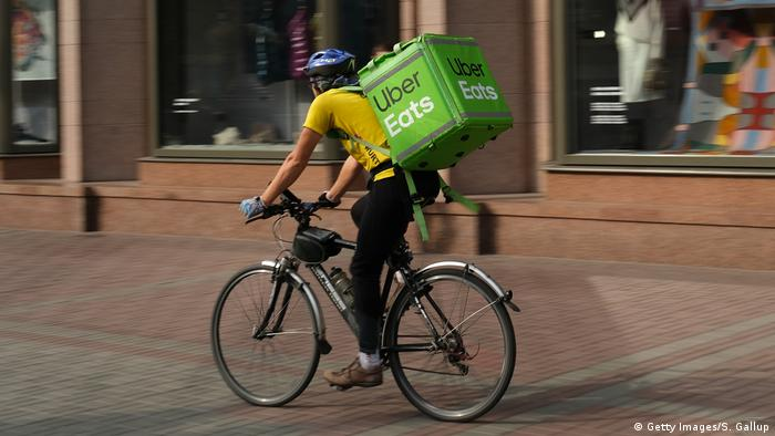 An uber eats food delivery courier on a bicycle