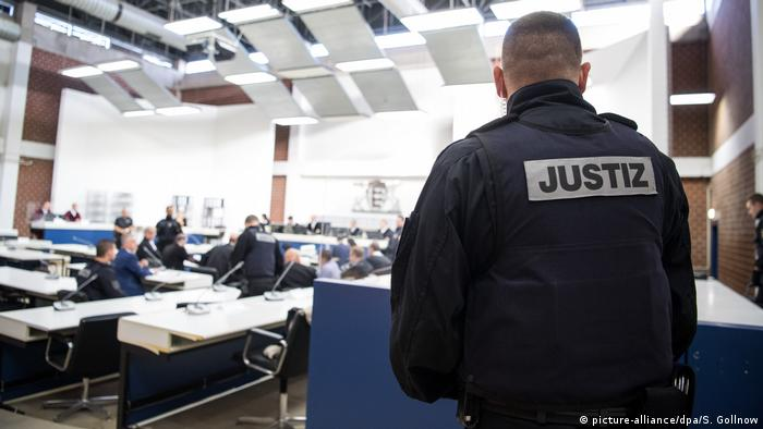 A court officer watches the proceedings of the case