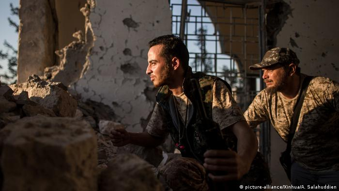 Fighters of UN-backed Government of National Accord (GNA) take positions on the ruins of a mosque