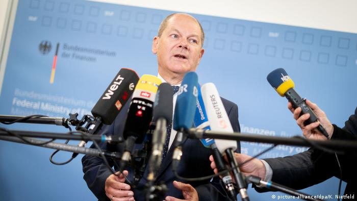 German Finance Minister Olaf Scholz speaking about the country's budget surplus in Berlin