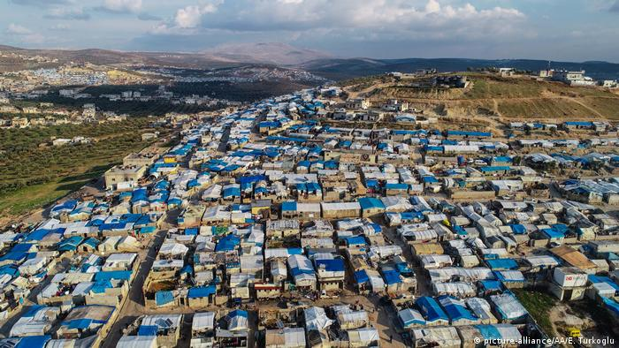 A drone photo shows tents at a camp hosting displaced Syrian families from Idlib. Erdal Turkoglu / Anadolu Agency.
