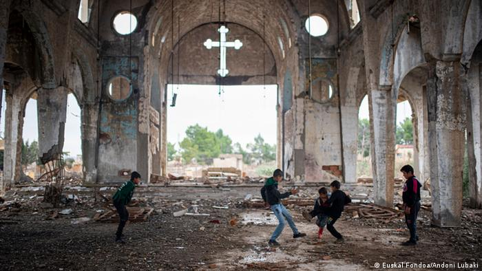 Children playing in an abandoned church