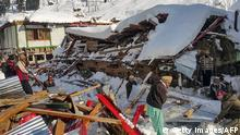 14.01.2020 *** Local residents remove debris of a collapsed house following heavy snowfall that triggered an avalanche in Neelum Valley, in Pakistan-administered Kashmir on January 14, 2020. - At least 42 people were killed and 21 wounded after heavy snowfall and rain hit Pakistan-administered Kashmir and the country's southwest, officials said. (Photo by STR / AFP) (Photo by STR/AFP via Getty Images)