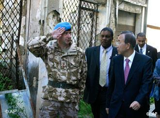 A UN soldier salutes as UN chief Ban Ki-moon walks along some of the narrowest points of the UN controlled buffer zone separating the internationally recognized Greek Cypriot south from the breakaway Turkish Cypriot north of Nicosia, the divided capital of ethnically split Cyprus