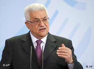 Palestinian President Mahmoud Abbas gestures during a news conference with the German Chancellor Angela Merkel (not in the picture) in the Chancellery in Berlin, Germany, Monday, Feb. 1, 2010. (AP Photo/Gero Breloer)