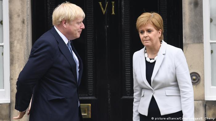 Boris Johnson (left) meets Nicola Sturgeon in Edinburgh