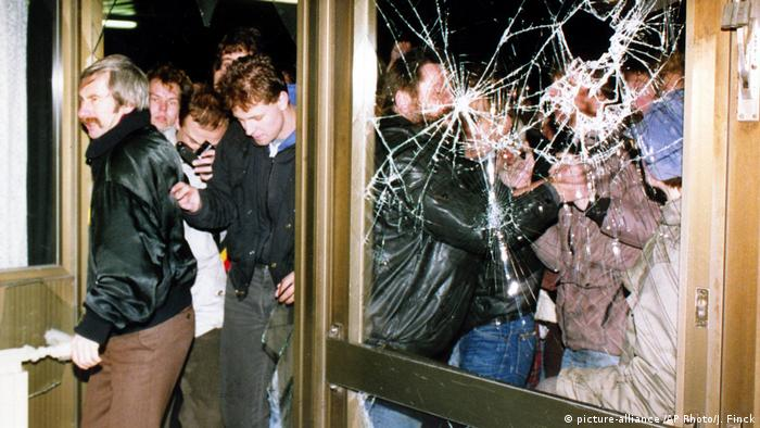 Protesters storming Stasi headquarters in 1990