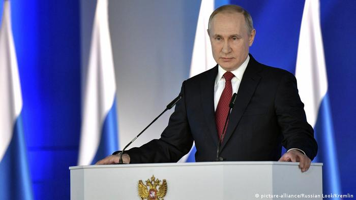 Russian President Vladimir Putin delivers an annual address to the Federal Assembly of the Russian Federation, at Moscow's Manezh Central Exhibition Hall