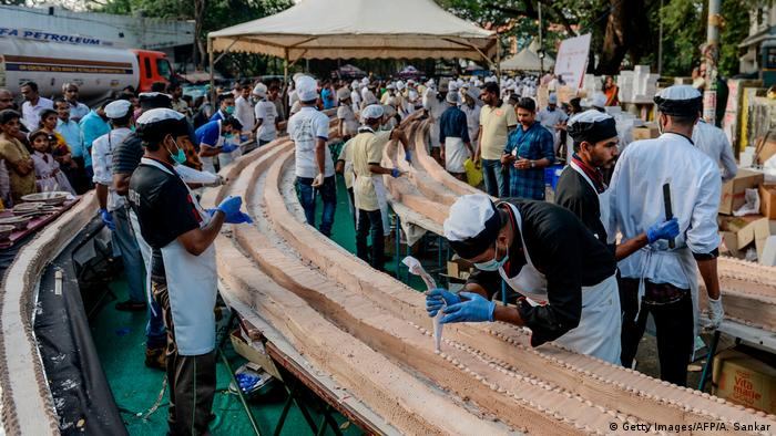 Bakers in India frost a cake that broke the record for world's longest