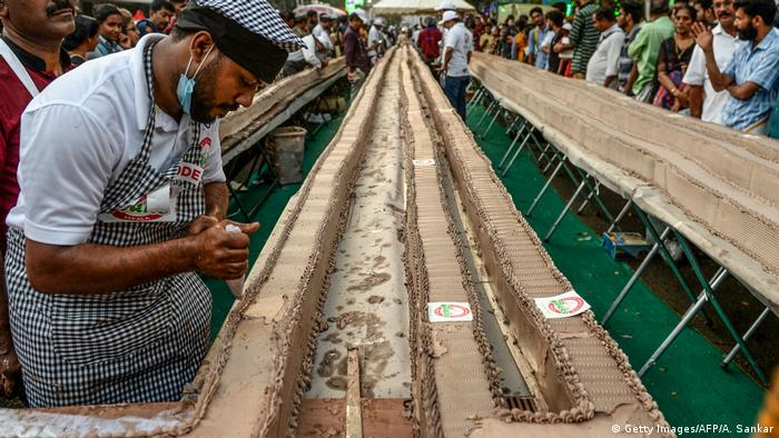 A baker prepares an approximately 6.5-km long cake as an attempt to break the Guinness World Record