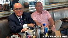 FILE PHOTO: U.S. President Trump's personal lawyer Rudy Giuliani has coffee with Ukrainian-American businessman Lev Parnas at the Trump International Hotel in Washington, U.S. September 20, 2019. REUTERS/Aram Roston/File Photo