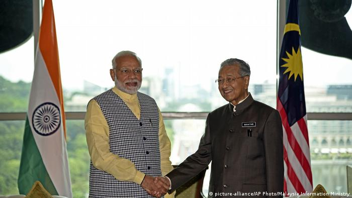 India's Prime Minister Narendra Modi, left, poses with Malaysia's Prime Minister Mahathir Mohamad at the Prime Minister's Office in Putrajaya, Malaysia, Thursday, May 31, 2018