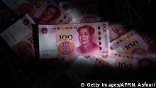 This photo illustration shows Chinese 100 yuan notes in Beijing on January 14, 2020. - The United States removed the currency manipulator label it imposed on China last summer, a sign of easing tensions between the economic powers after nearly two years of conflict. Separately, official data showed that Chinas trade surplus with the United States narrowed in 2019, a day before the two countries sign a phase one trade deal in Washington. (Photo by NICOLAS ASFOURI / AFP) (Photo by NICOLAS ASFOURI/AFP via Getty Images)