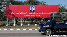 A police van drives by a banner welcoming Chinese President Xi Jinping ahead of his visit to Myanmar in Naypyitaw, Myanmar, January 16, 2020. REUTERS/Ann Wang