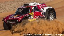 Driver Carlos Sainz, of Spain, and co-driver Lucas Cruz, of Spain, race their Mini during stage eleven of the Dakar Rally between Shubaytah and Haradth, Saudi Arabia, Thursday, Jan. 16, 2020. (AP Photo/Bernat Armangue) |