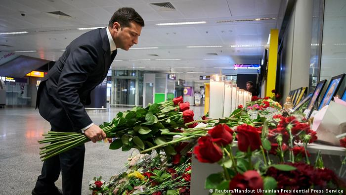 Ukraine President Volodymyr Zelenskiy lays flowers for the victims of the Iran plane crash (Reuters/Handout Ukrainian Presidential Press Service)
