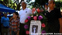 People attend a commemoration for El Mozote massacre, executed by the army during El Salvador's 1980-1992 civil war, in El Mozote, 200 km east of San Salvador, on December 7, 2019. - Salvadoreans are commemorating the 38th anniversary of the massacre with the hope that the soldiers accused of the infamous event in which according to official figures 986 people, including 558 children, were killed, are punished. More than 75,000 people were killed or went missing during the country's civil war. (Photo by MARVIN RECINOS / AFP) (Photo by MARVIN RECINOS/AFP via Getty Images)