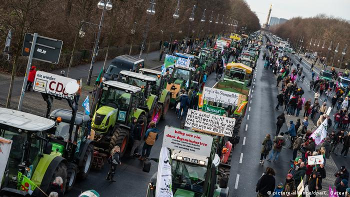 Tractors line up on a main street in Berlin