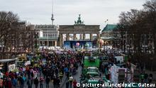 Protesters gather at Brandenburg Gate during Green Week in Berlin