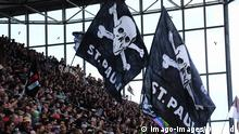 HAMBURG, GERMANY - APRIL 27: Fans of FC Sankt Pauli looks on prior to the second Bundesliga match between FC Sankt Pauli and SSV Jahn Regensburg at Millerntorstadion on April 27, 2019 in Hamburg, Germany. DFL regulations prohibit any use of photographs as image sequences and/or quasi-video. *** HAMBURG GERMANY APRIL 27 Fans of FC Sankt Pauli looks on prior to the second Bundesliga match between FC Sankt Pauli and SSV Jahn Regensburg at Millerntorstadion on April 27, 2019 in Hamburg Germany DFL regulations prohibit any use of photographs as image sequences and or quasi video