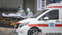 WUHAN, CHINA - JANUARY 17: (CHINA OUT) Medical staff transfer patients to Jin Yintan hospital on January 17, 2020 in Wuhan, Hubei, China. Local authorities have confirmed that a second person in the city has died of a pneumonia-like virus since the outbreak started in December. (Photo by Getty Images)