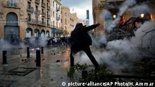 Anti-government protesters clash with the riot police, during a protest at a road leading to the parliament building in Beirut, Lebanon, Saturday, Jan. 18, 2020. Riot police fired tears gas and sprayed protesters with water cannons near parliament building to disperse thousands of people after riots broke out during a march against the ruling elite amid a severe economic crisis. (AP Photo/Hassan Ammar)