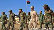 Fighters of a military battalion loyal to Libyan General Khalifa Haftar march during the morning assembly in the eastern city of Benghazi on December 18, 2019. (Photo by Abdullah DOMA / AFP) (Photo by ABDULLAH DOMA/AFP via Getty Images)