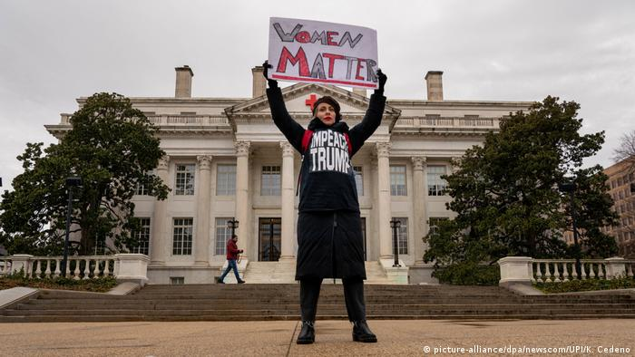A woman holds up a Women matter sign in front of the Red Cross building as thousands turn out for the fourth annual Women's March rebuking President Donald Trump and his administration in Washington