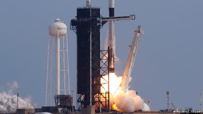 A SpaceX Falcon 9 rocket, carrying the Crew Dragon astronaut capsule, lifts off during a test