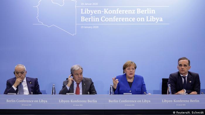 Germany's Chancellor Angela Merkel and Germany's Foreign Minister Heiko Maas attend a news conference