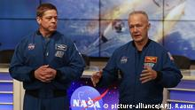 Astronauts Bob Behnken, left, and Doug Hurley answer questions during a news conference after a Falcon 9 SpaceX rocket test flight demonstrating the capsule's emergency escape system at the Kennedy Space Center in Cape Canaveral, Fla., Sunday, Jan. 19, 2020. The two astronauts will be the first crew of the SpaceX manned capsule. (AP Photo/John Raoux) |