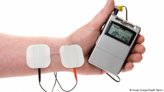 A handheld device that provides pain relief using electricity