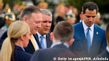 US Secretary of State Mike Pompeo (L), Colombian President Ivan Duque (C) and Venezuelan opposition leader Juan Guaido walk during the inauguration of the III Hemispheric Ministerial Conference of Fight Against Terrorism in Bogota, on January 20, 2020. - US Secretary of State Mike Pompeo called on Monday for cooperation in the struggle to remove Venezuela President Nicolas Maduro from office amidst a chronic economic crisis in the South American country. (Photo by Raul ARBOLEDA / AFP) (Photo by RAUL ARBOLEDA/AFP via Getty Images)