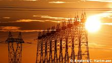 The sun sets behind pylons of high-tension electricity power lines outside Goussainville, near Paris, France, August 8, 2017. REUTERS/Christian Hartmann - RC16FA11A400