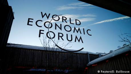 A logo of the 50th World Economic Forum (WEF) annual meeting is pictured on a window in Davos