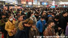 People wait to board trains at Hongqiao Railway Station in Shanghai on January 20, 2020, ahead of the Lunar New Year. - China is in the midst of its annual travel rush as millions head to their hometowns to enjoy a week-long holiday to welcome in the Lunar New Year of the Rat. (Photo by HECTOR RETAMAL / AFP) (Photo by HECTOR RETAMAL/AFP via Getty Images)