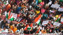 Members of the Christian community along with social activists hold placards and Indian flags as they take part in a rally to protests against the Indian government's Citizenship Amendment Act (CAA), in Kolkata on January 20, 2020. (Photo by Dibyangshu SARKAR / AFP) (Photo by DIBYANGSHU SARKAR/AFP via Getty Images)
