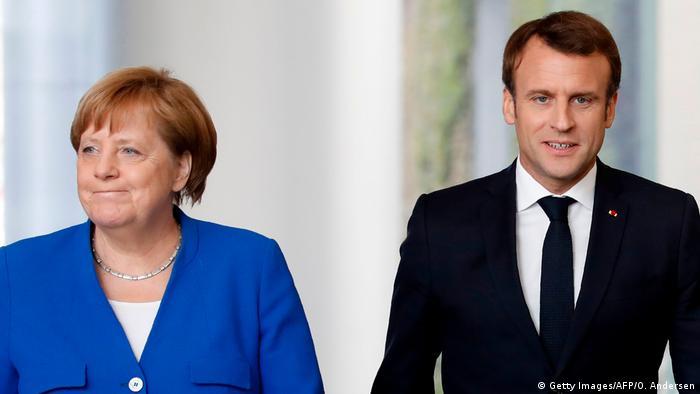 Berlin | Angela Merkel und Emmanuel Macron (Getty Images/AFP/O. Andersen)