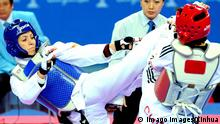 China 2010 | Asian Games | Taekwondo | Parisa Farshidi, Iran & Guo Yunfei, China (Imago Images/Xinhua)