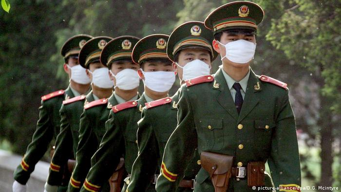 Chinese soldiers with facemasks