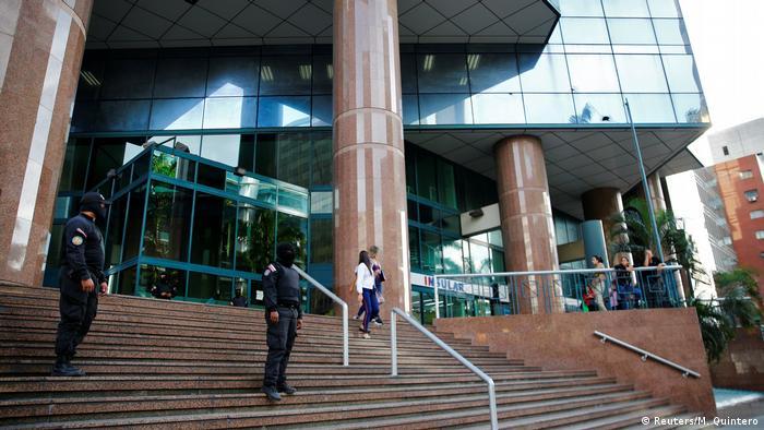 SEBIN officials stand outside Guaido's office