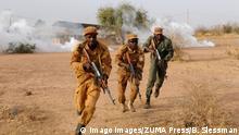 March 2, 2017 - Ouagadougou, Burkina Faso - Burkinabe soldiers utilize smoke cover to regroup after an ambush exercise at Camp Zagre March 2, 2017 in Ouagadougou, Burkina Faso. Ouagadougou Burkina Faso PUBLICATIONxINxGERxSUIxAUTxONLY - ZUMAp138 20170302_zaa_p138_032 Copyright: xBritanyxSlessmanx March 2 2017 Ouagadougou Burkina Faso Burkinabe Soldiers utilize Smoke Cover to regroup After to Ambush EXERCISE AT Camp Zagre March 2 2017 in Ouagadougou Burkina Faso Ouagadougou Burkina Faso PUBLICATIONxINxGERxSUIxAUTxONLY ZUMAp138 20170302_zaa_p138_032 Copyright xBritanyxSlessmanx