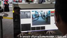 January 22, 2020, Medan, North Sumatra, Indonesia: An officer checks the monitor for passengers who pass through a thermal scanner upon their arrival at Kualanamo International Airport, in North Sumatra on January 22, 2020. According to media reports, a virus that spreads from Wuhan China to a new type of corona virus when concerns about the mysterious infectious disease were has infected nearly 300 people, and six people have died. (Credit Image: © Albert Ivan Damanik/ZUMA Wire |