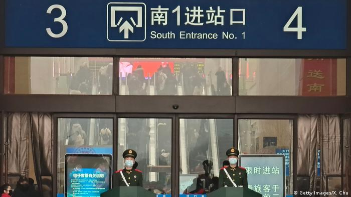 Police in face masks at a train station