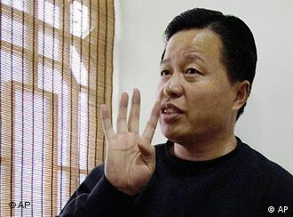 FILE - In this Friday, Feb. 24, 2006 file photo, Gao Zhisheng gestures during an interview at a tea house in Beijing, China. The Chinese human rights lawyer missing for almost a year has been judged by legal authorities and is where he should be, a Foreign Ministry official said in China's first public comment on the case. (AP Photo/Ng Han Guan, File)