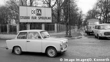 Trabant (East German car) on a city corner with a sign in the back reading DEFA: Studio for Films. DEFA Studios Babelsberg (Imago Images/D. Konnerth)