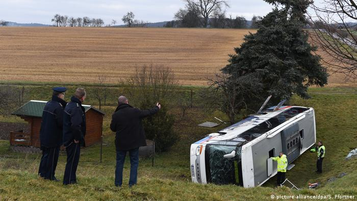 Police investigate the scene of a fatal school bus crash near the town of Eisenach in eastern Germany