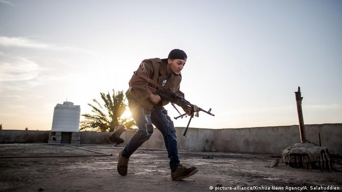 A fighter of the forces of the UN-backed Government of National Accord (GNA) is seen during clashes with east-based Libyan National Army (LNA) troops near Tripoli international airport, Tripoli, Libya