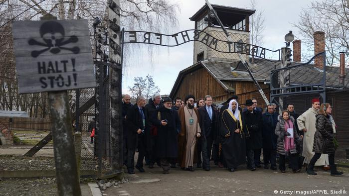 Muslim and Jewish leaders stand together in solidarity at Auschwitz